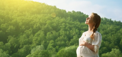 pregnant woman relaxing and enjoying life in nature